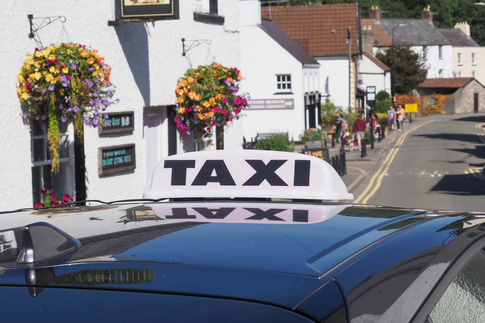 CHEPSTOW, UK - CIRCA SEPTEMBER 2019: taxi sign on a car